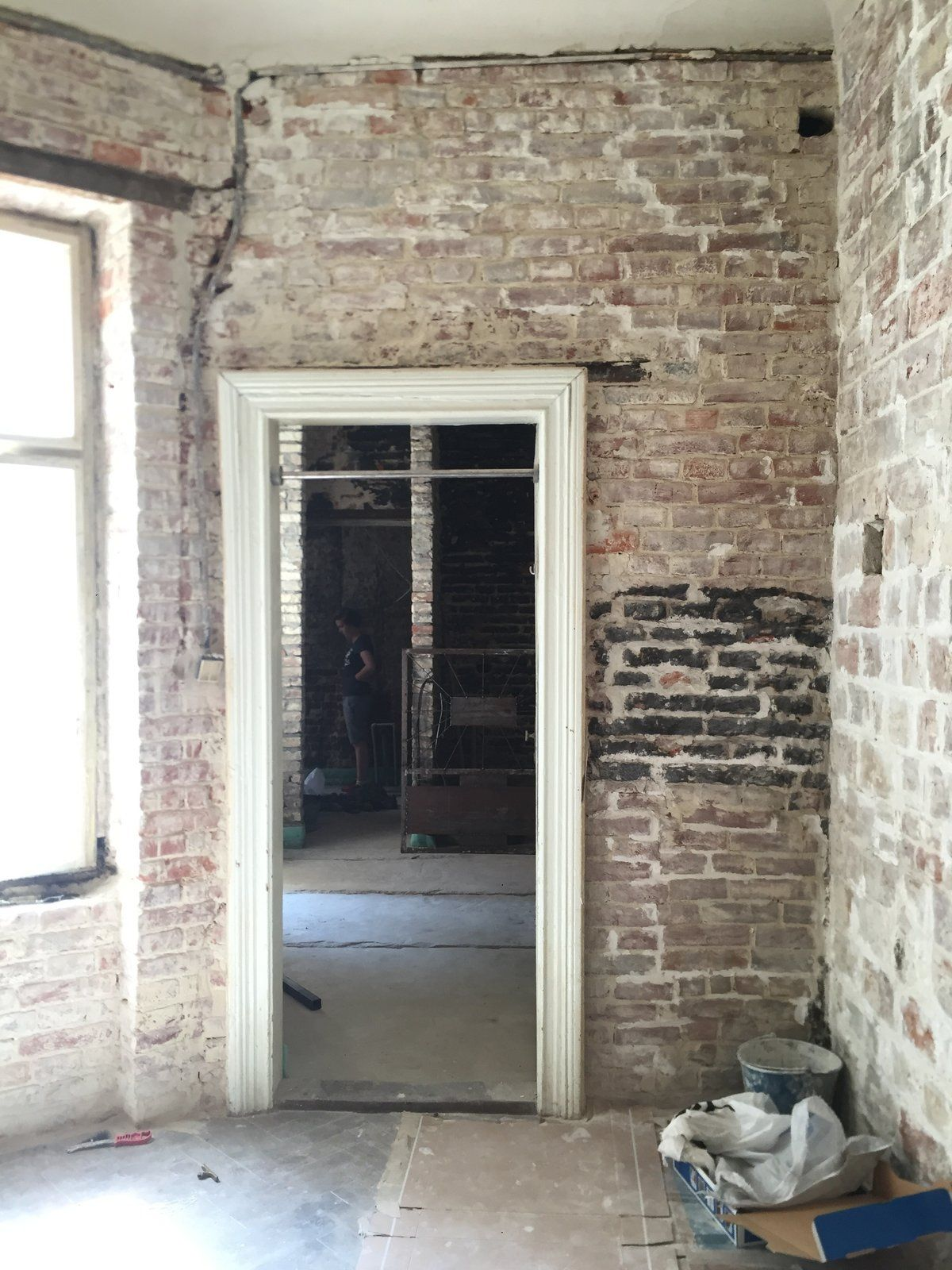 Inside, The Old Brick Walls Were Kept Intact And Painted