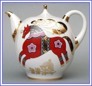 Lomonosov Red Horse pattern Russian porcelain teapot, handpainted horse and cockerels in red and black on white body w/ 22 karat gold highlights, flattened ovoid shape, c. 2001, Saint Petersburg, Russia