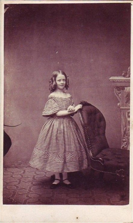 Girl with curls and a striped dress, mid-19th C.