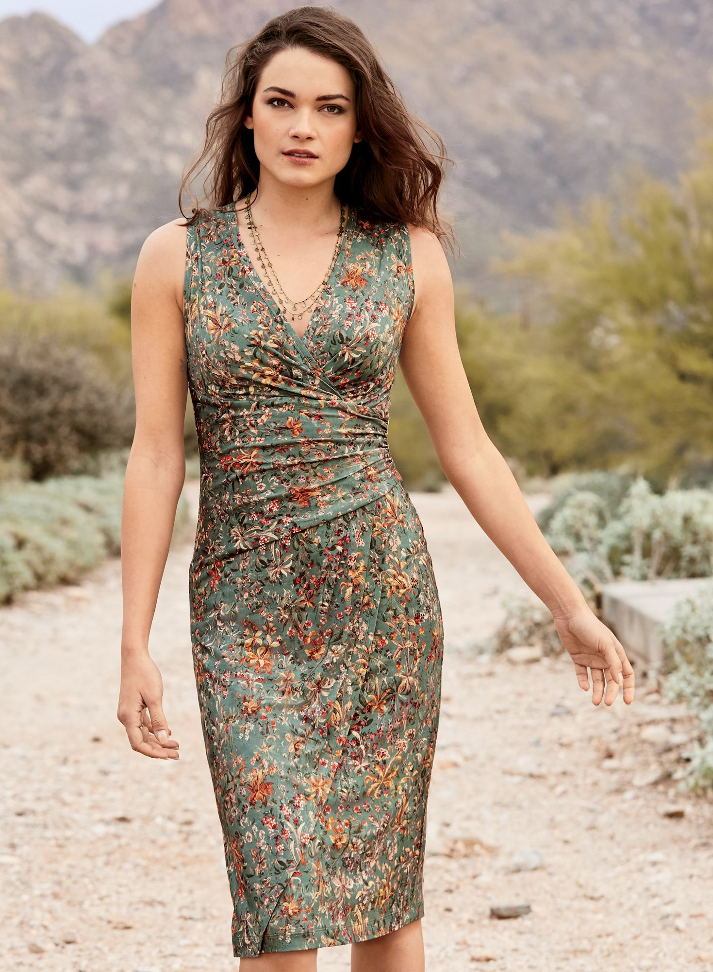 3f4410d1d8901 A sultry silhouette, the faux-wrap dress of sage viscose and elastane  jersey is