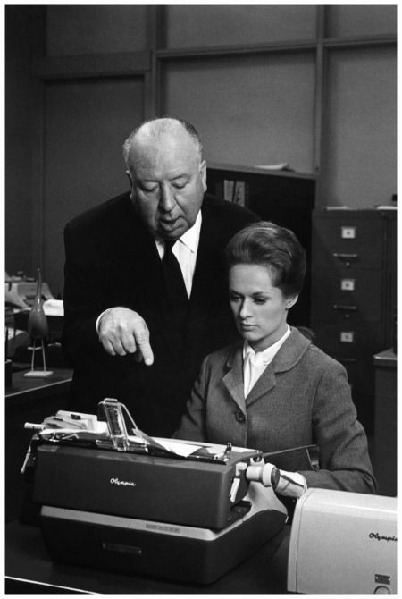 Tippi Hedren and Alfred Hitchcock on the set of Marnie (1964)