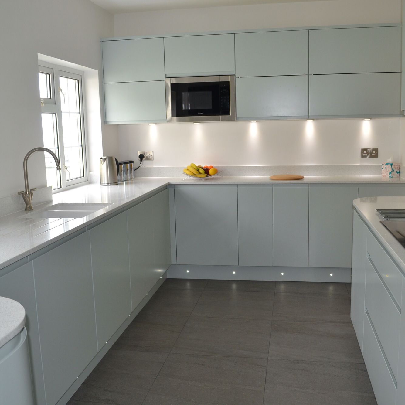 Grey slate floor tiles compliment the sleek lines of the kitchen grey slate floor tiles compliment the sleek lines of the kitchen dailygadgetfo Images