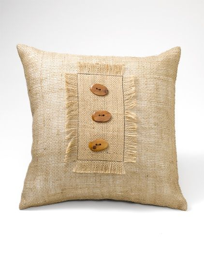 Woven jute pillow with wood buttons