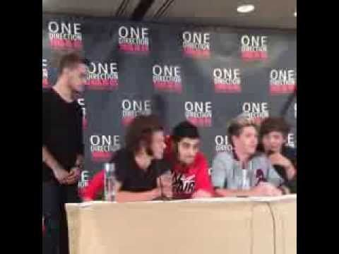 Zayn and Louis sharing chairs with Niall and Harry - Liam is me at every social event.
