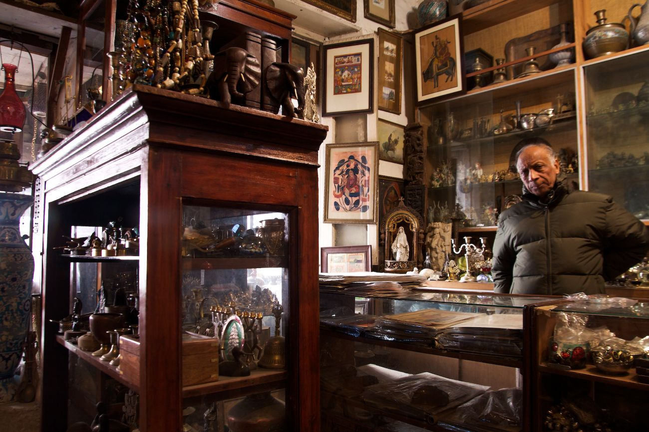 Shop counter - Vinod Kumar, stands behind display counter ...