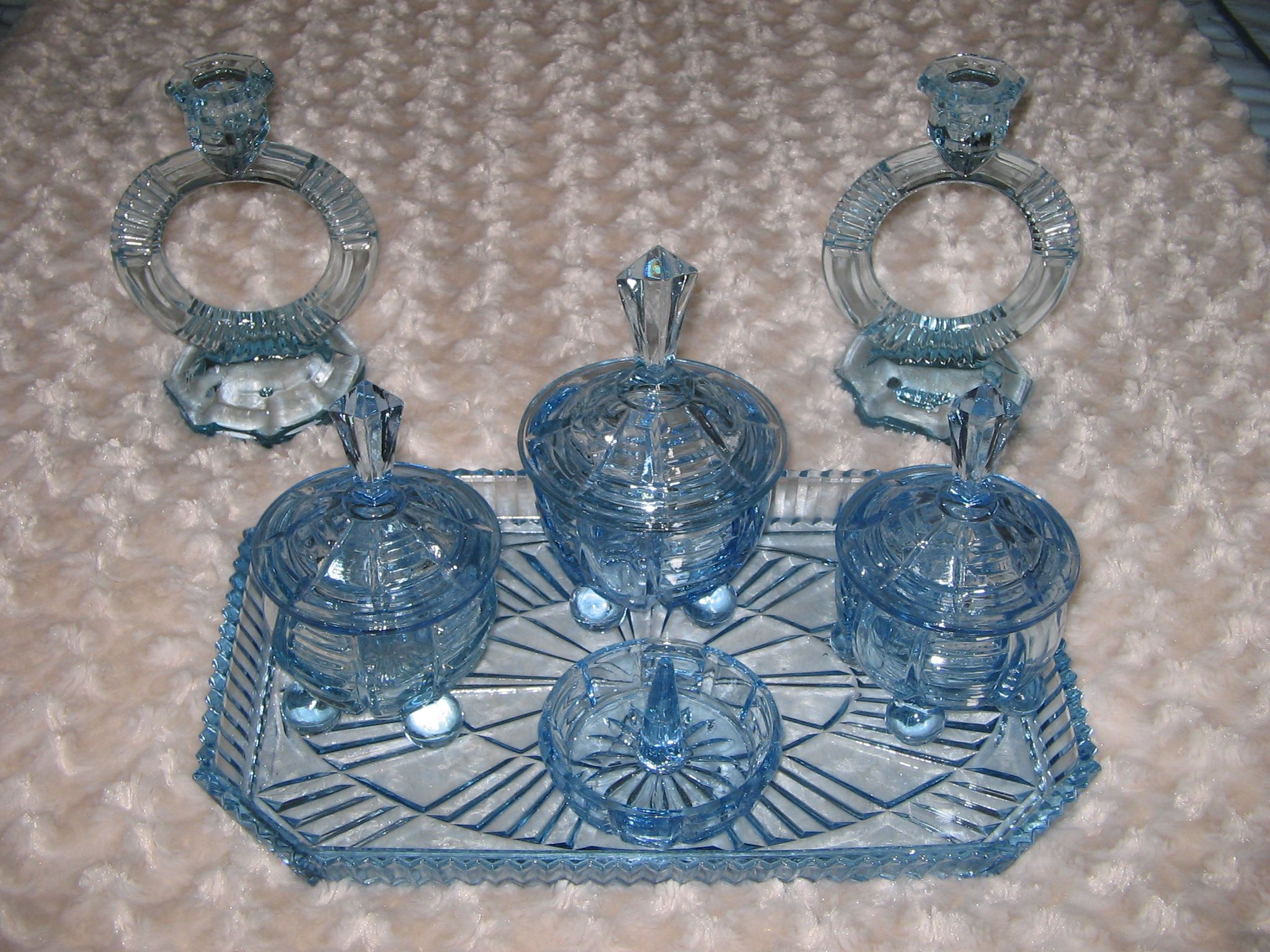 Blue pressed glass dressing table set with ball feet by