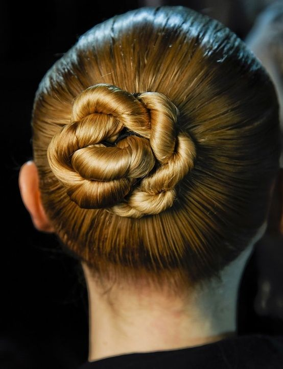 Long Hair Style Idea: Twist Bun Updo for Summer 2013 – 2014 Hot from the runways of New York and Europe, this sleek twisted chignon is fabulously trendy at the moment! This look depends on the smoothness of the hair around the head, which is styled with a gel-cream for a clean, slick silhouette and[Read the Rest]