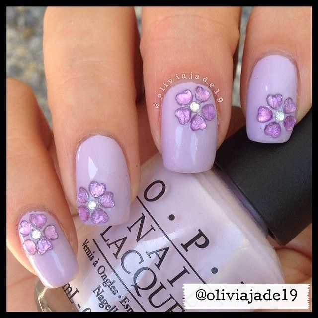Instagram photo by oliviajade19 #nail #nails #nailart light purple fingernail polish with purple flower jems on top of polish