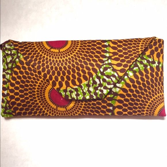 Ankara clutch A clutch that's a little too cute for words! With just enough space to stash your must-haves (lipgloss, cell phone, wallet, keys, and sunglasses) this compact style goes from daytime fun to evening with flair. Bags Clutches & Wristlets