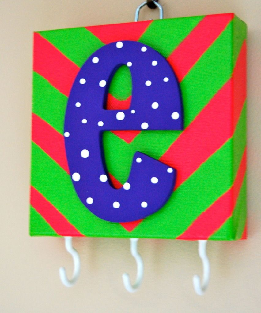 easy key holder! paint a canvas, letter, attach with hot