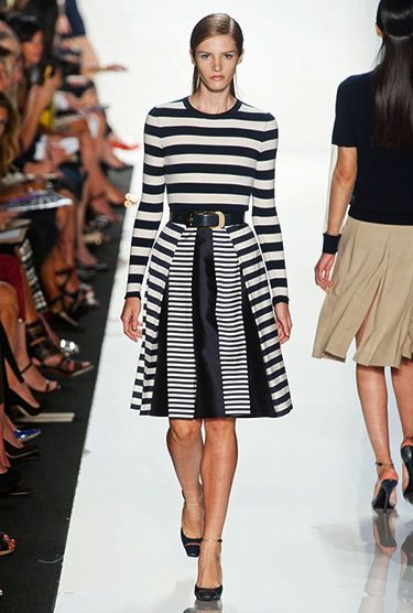BLACK AND WHITE STRIPES       Michael Kors showed a unique combination of black and white stripes for his Spring 2013 collection. The differing widths of the stripes accentuate the pleating on this classic fit-and-flare dress.