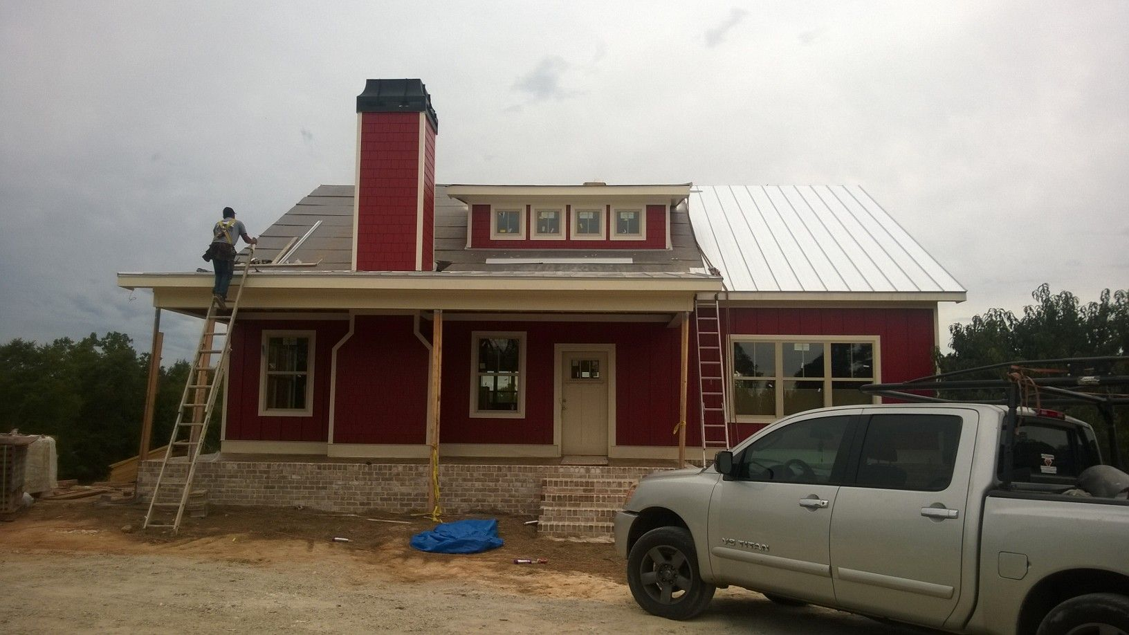 Standing seam roofing being installed