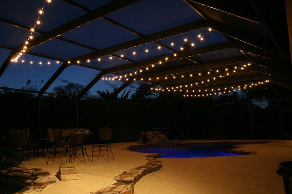 Hanging Market Lights Over A Pool Deck In Tampa, FL.