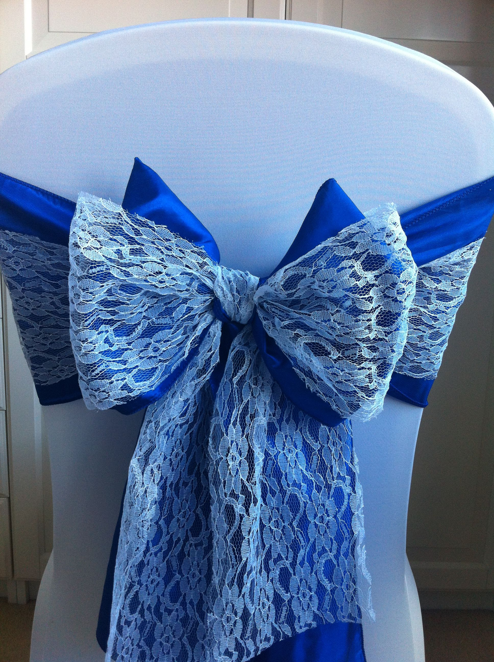 White spandex chair cover with royal blue bow and lace sashes