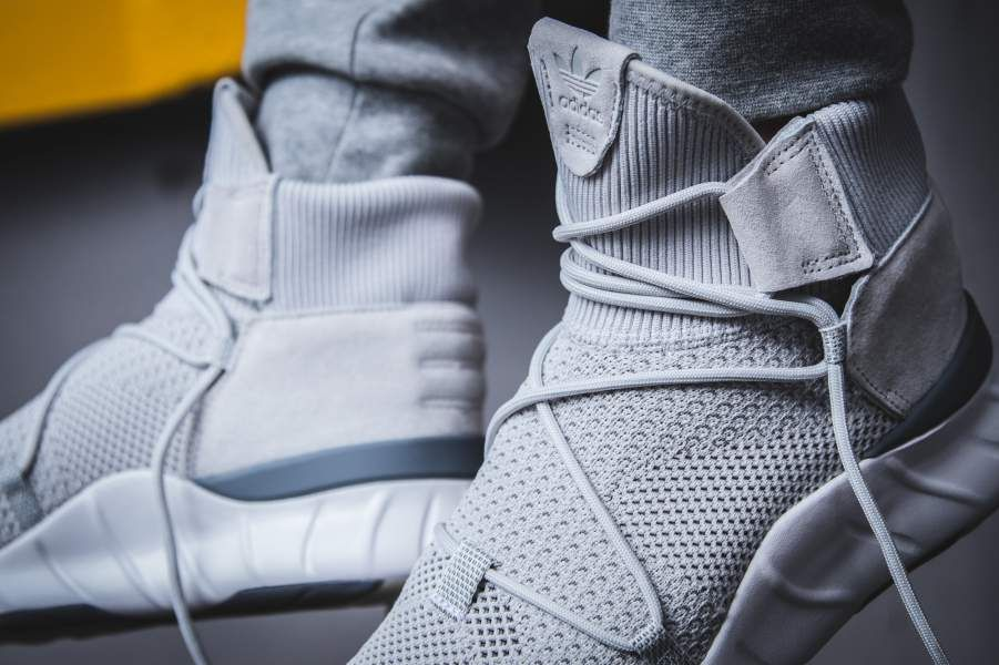 The adidas Tubular X 2.0 Primeknit Grey White edition is featured in a  lifestyle look and cc625c3bf