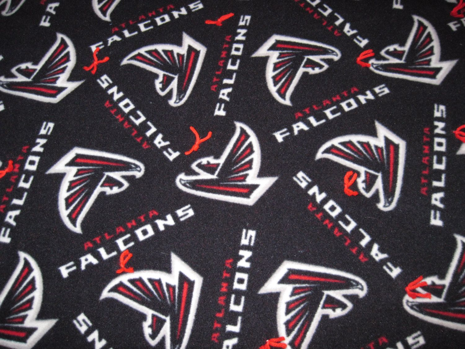 Atlanta Falcons blanket with red backing by JandJblankiesandETC on Etsy