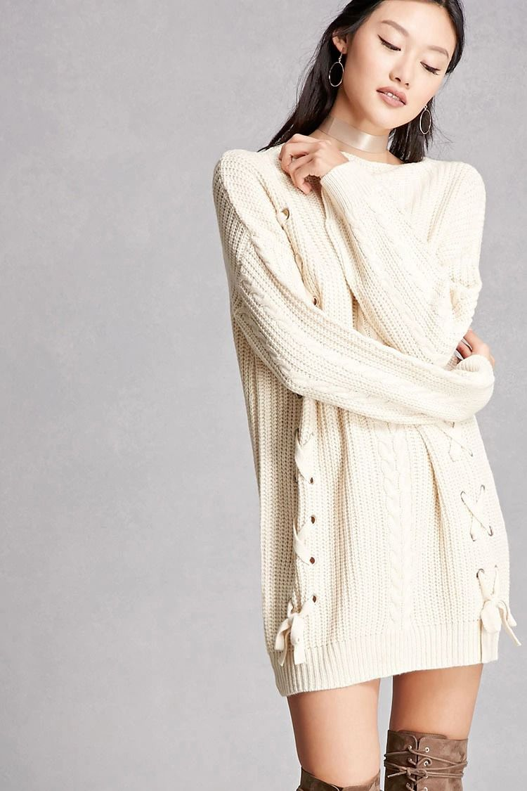 5ffce853a1 A midweight cable knit sweater featuring a longline silhouette