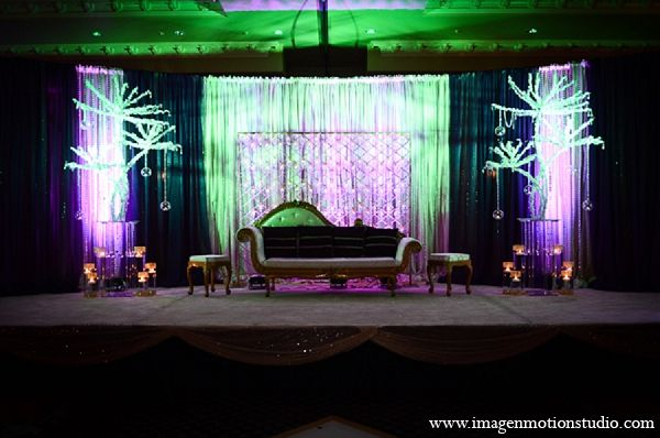 indian wedding reception decor stage purple green lighting http