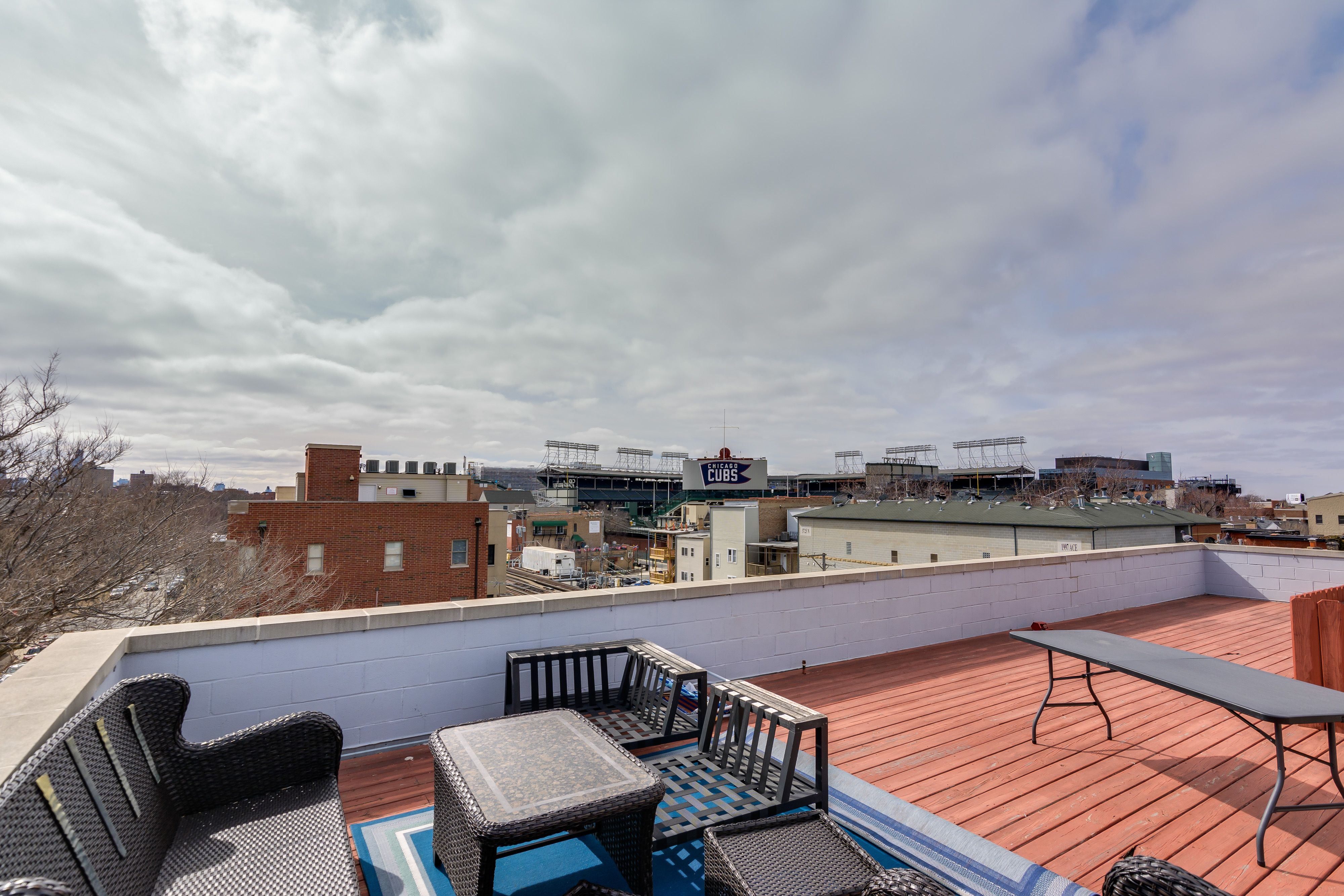 Minimalist Rooftop Deck With Views Of Wrigleyville And The City