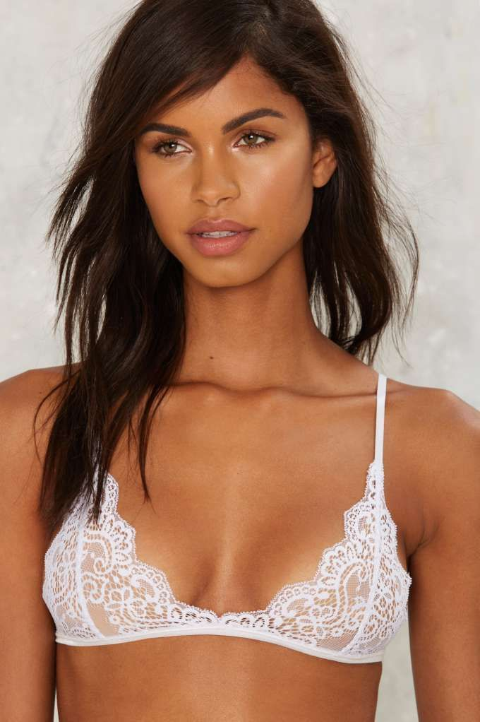 1c7a8bee6a2 Kill it every time in this sheer white lace bralette featuring floral lace  detailing and scalloped trim.