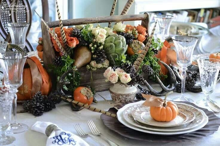 nature inspired fall thanskgiving dinner tablescape place setting, pumpkins, pinecones, quail feathers