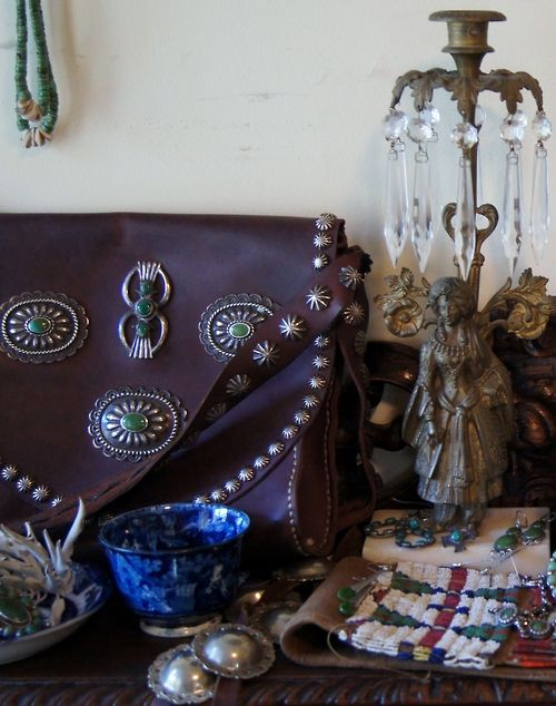 Leather purse with concho and buttons by silversmith Greg Thorne.