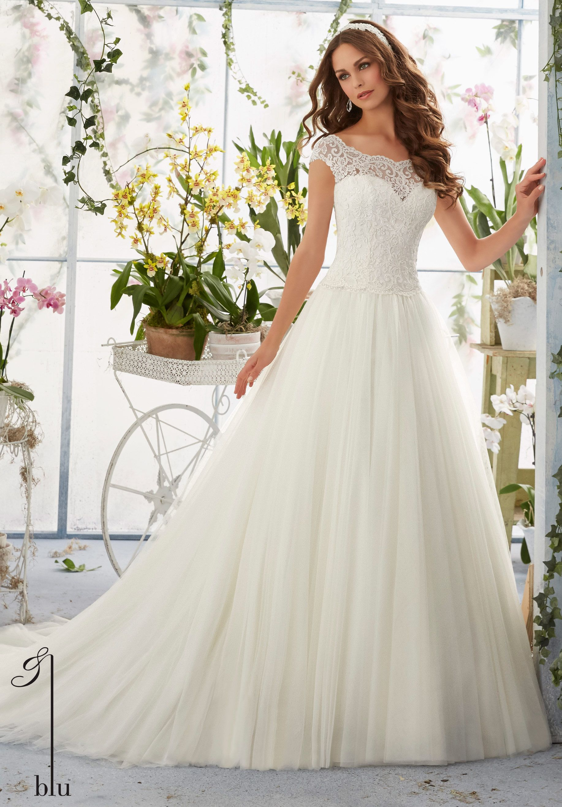 2016 wedding gown by featuring embroidered lace overlays for Lace wedding dress overlay