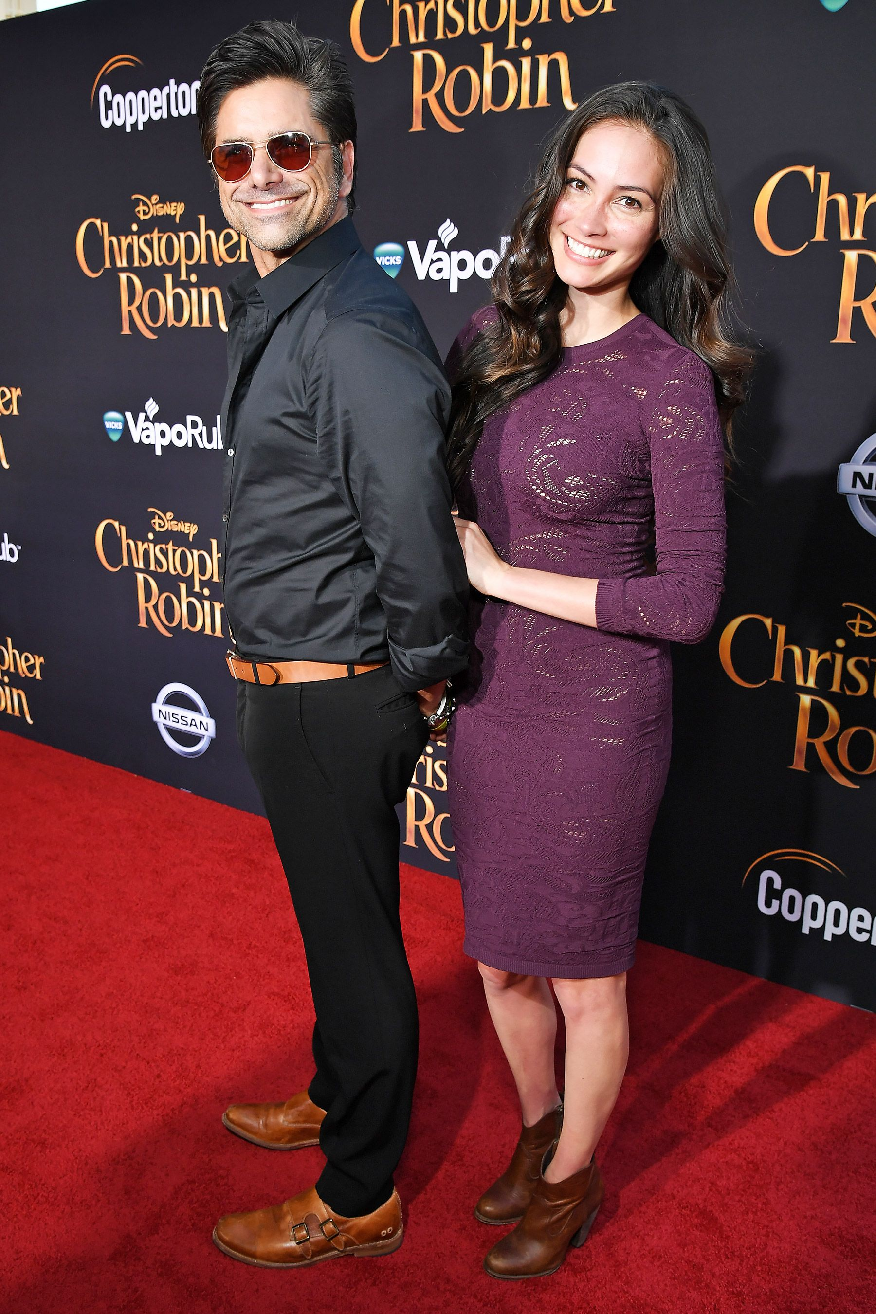 02e5b918051 John Stamos and wife Caitlin McHugh, who are also parents to adorable son  Billy, are one cute couple at the L.A. premiere of Christopher Robin on  Monday.