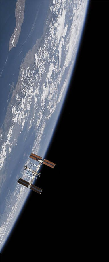 The International Space Station (ISS) aligned with Earth's