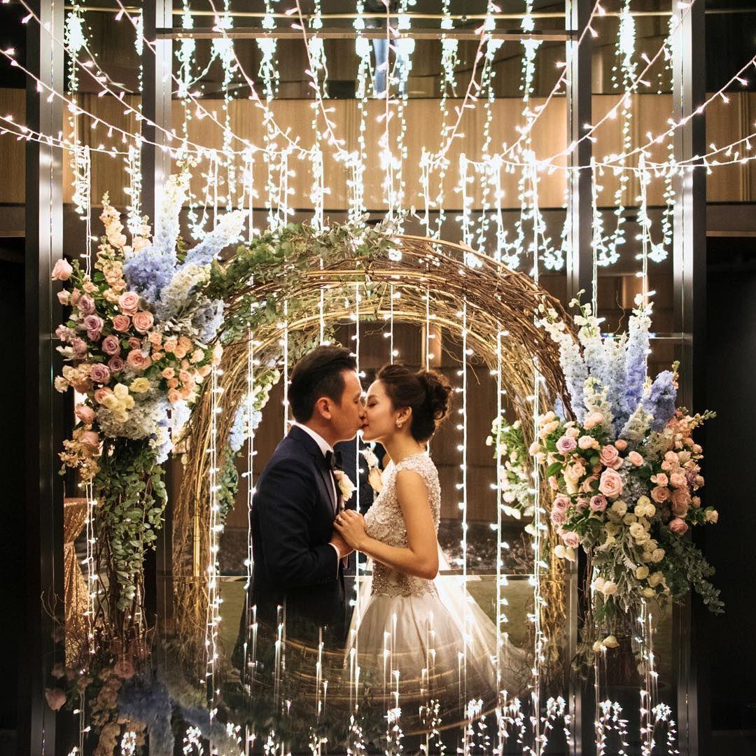 wedding arch with a fairy light backdrop decor arch