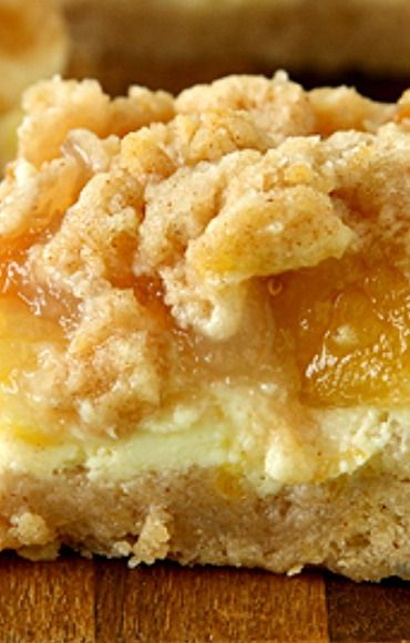 Peach Cheesecake Crumb Bars ~ Delectable cinnamon crumb bars with creamy cheesecake and sweet peach pie filling. #peachcobblercheesecake