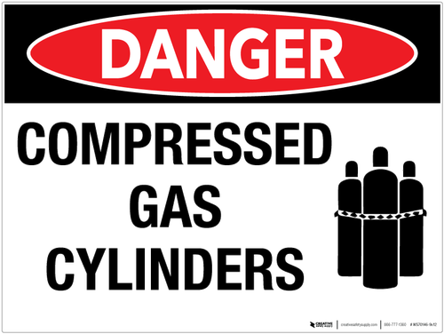 """Hanging a wall sign that reads, """"Danger Compressed Gas"""