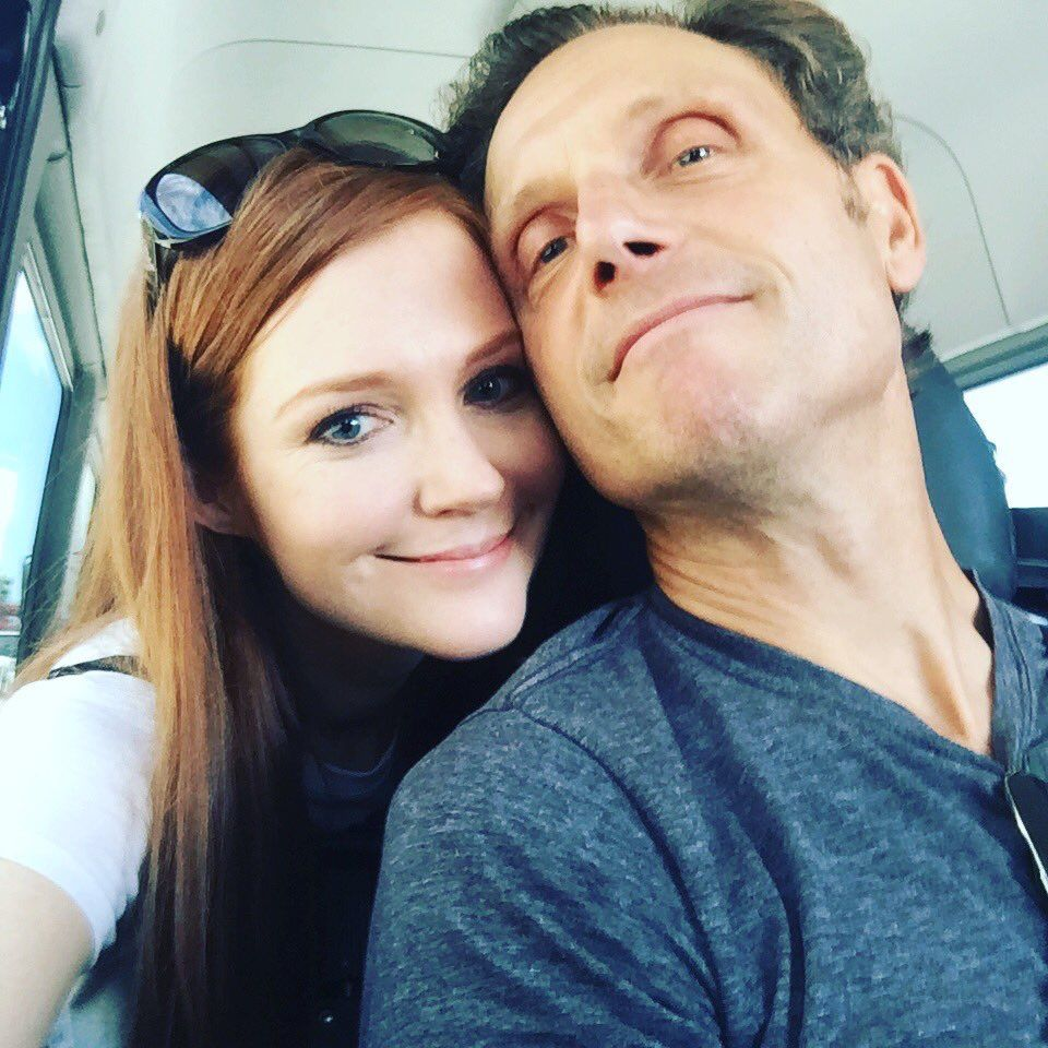 Katie lowes long wavy casual hairstyle thehairstyler com - Darby Stanchfield Tony Goldwyn