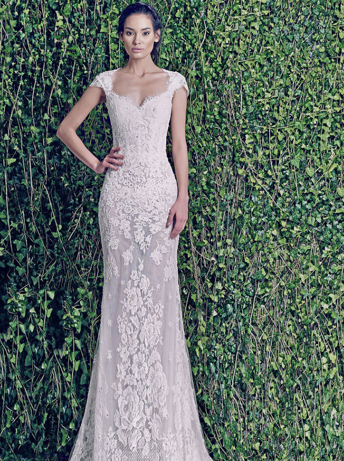 Zuhair Murad trumpet dress with lace cap sleeves, sweetheart neckline, lace corset bodice, princess seams, and sheer lace skirt.