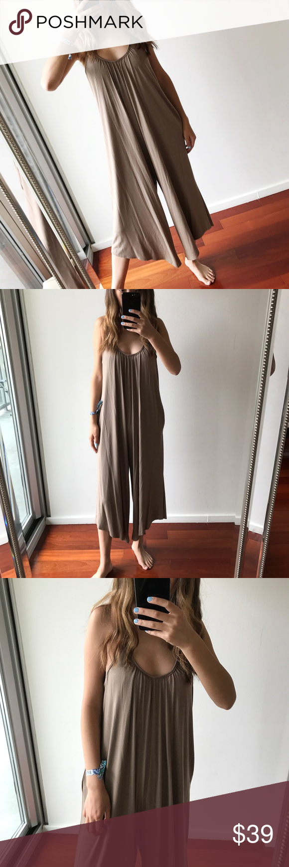 """Cappuccino Buttery Draped Jumpsuit Doesn't get more comfortable than this. Lounge around in this flow-y jumpsuit all day, and you might even be tempted to wear it to bed… This piece is easy to slip on and best paired with flip flops/flats/sandals for comfort OR simple heels for added height and panache.  -Buttery soft touch -Drapes well -Scoop neck detail -95% rayon, 5% spandex -Measurements of a S for reference: 15"""" pit to pit, 47"""" shoulder to hem 1"""" difference all around, for all sizes…"""