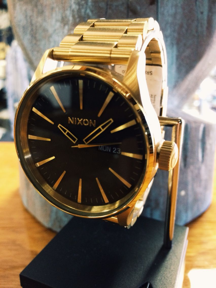 3beecce4228 Nixon Sentry SS Gold and Black Watch