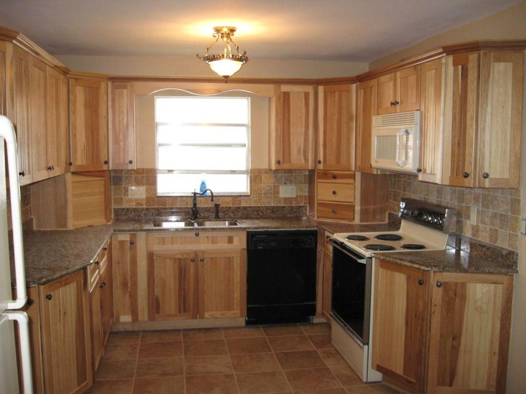 med brown counter neutral back splash  Hickory cabinets