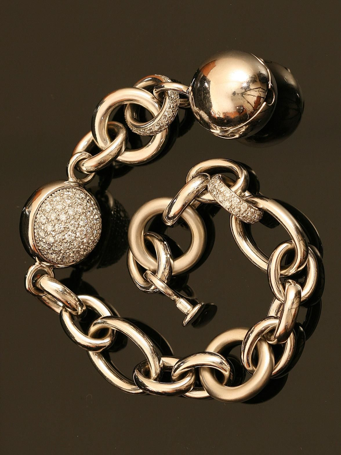 Pomellato 18KT White Gold Diamond Link Bracelet with Pave Set Diamond Ball and Links. Available at London Jewelers.