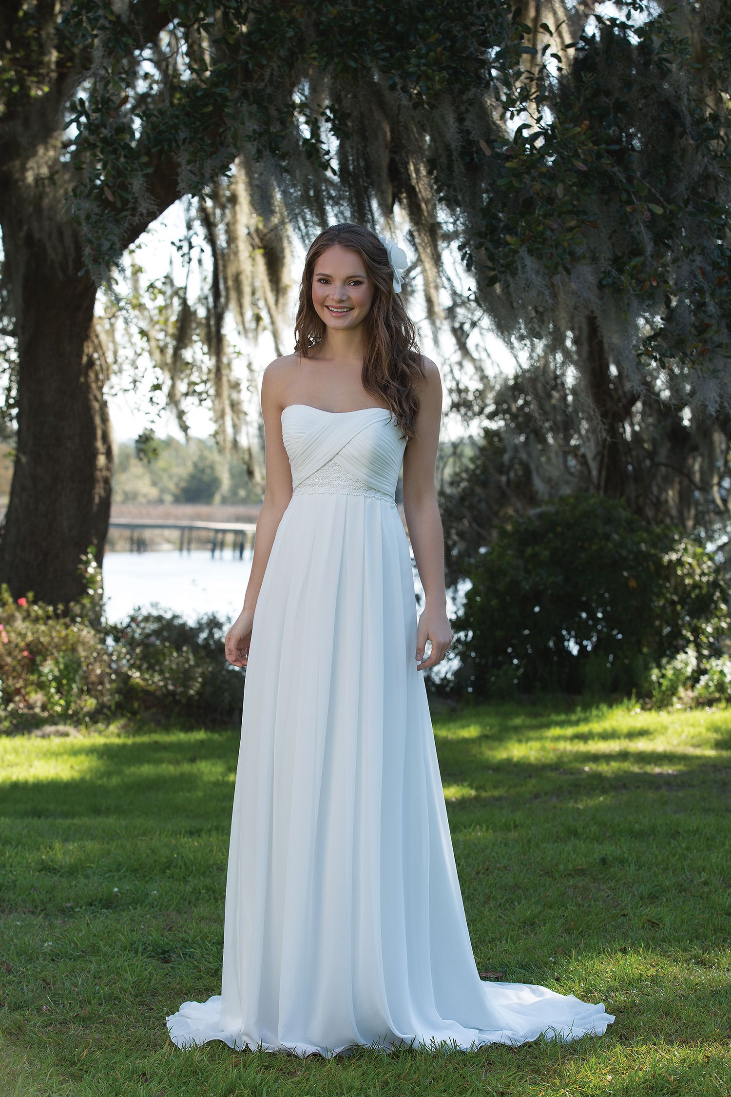 The delicate details of this Grecian inspired strapless gown include ...