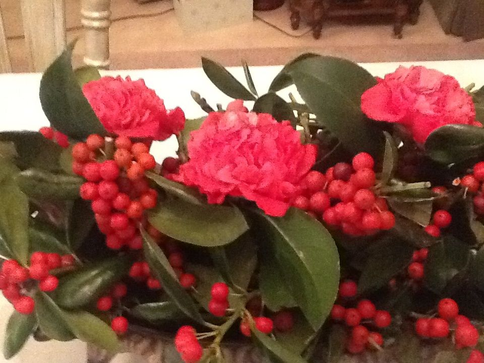Close up of holly and camellia arrangement