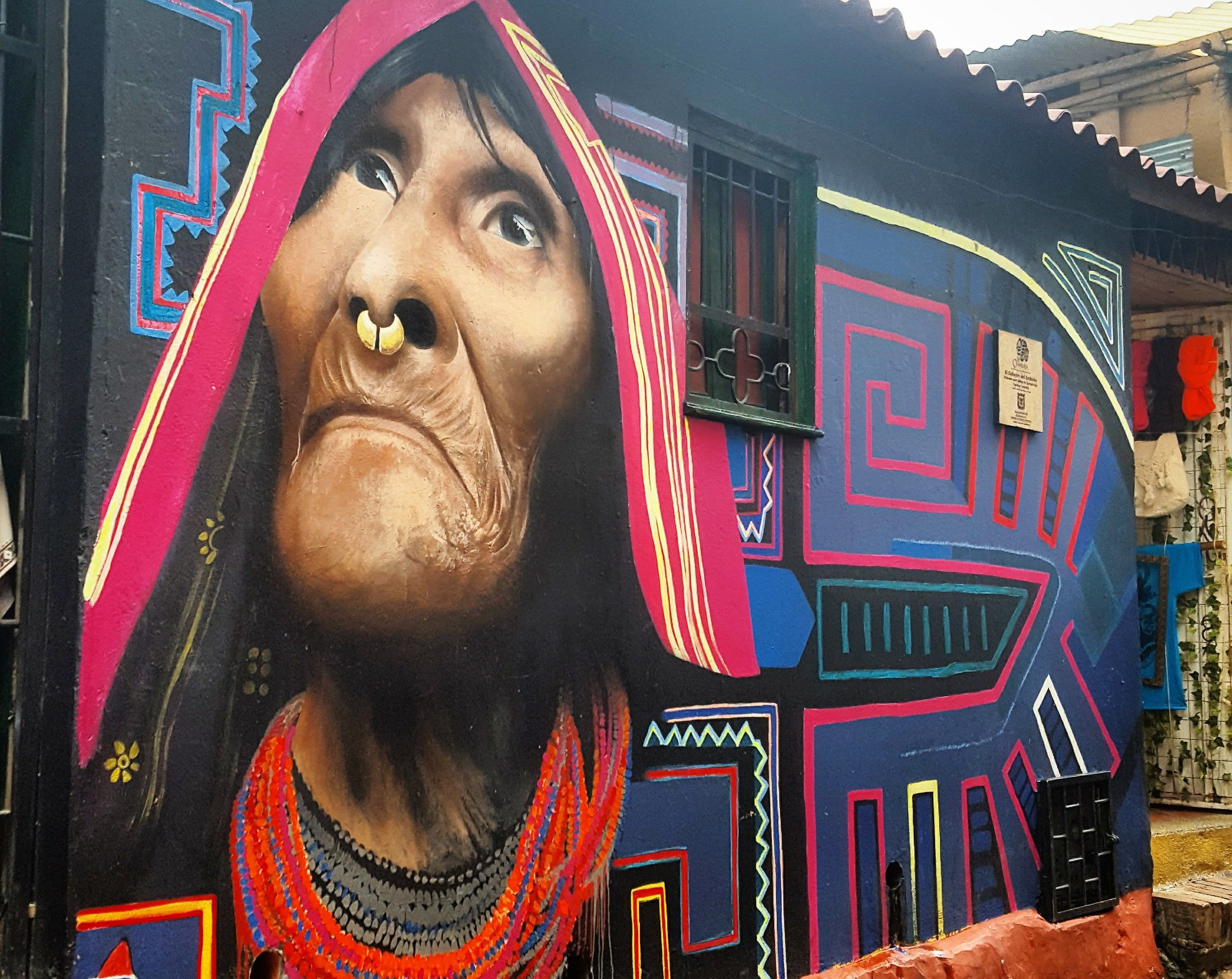 An impressive Mural of an indigenous Kuna Woman in Colombia's Capital. Check out Bogota's moving STreet Art History!