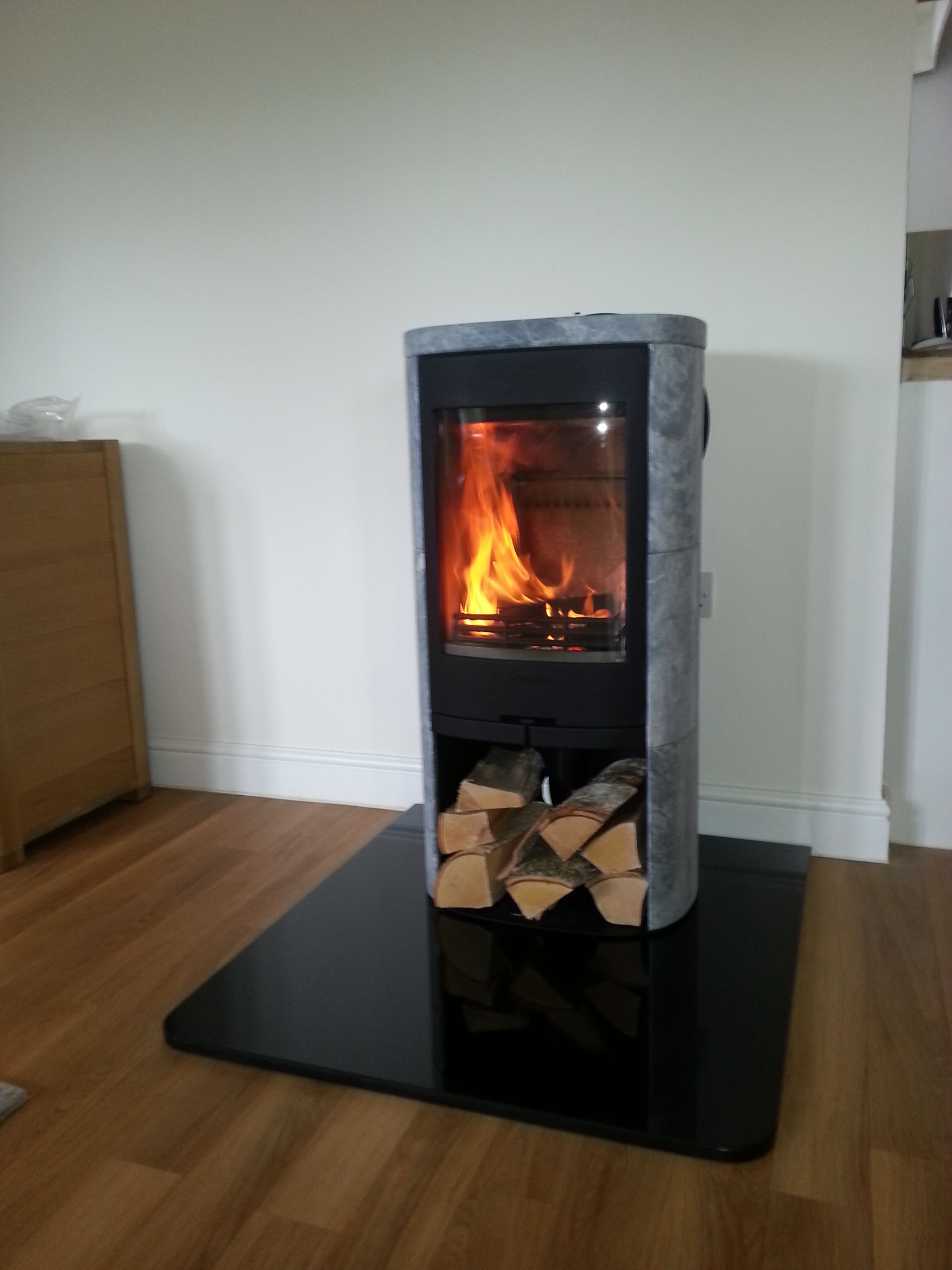A Contura 820T (Soapstone) in grey with a solid granite hearth. Granite  HearthWood Burning StovesWood ...