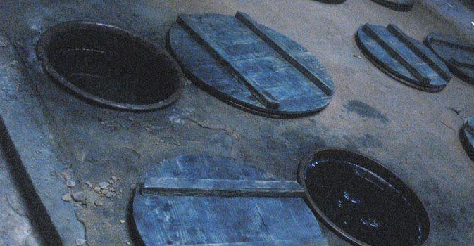 workroom with indigo pots sunk deep into the flooring