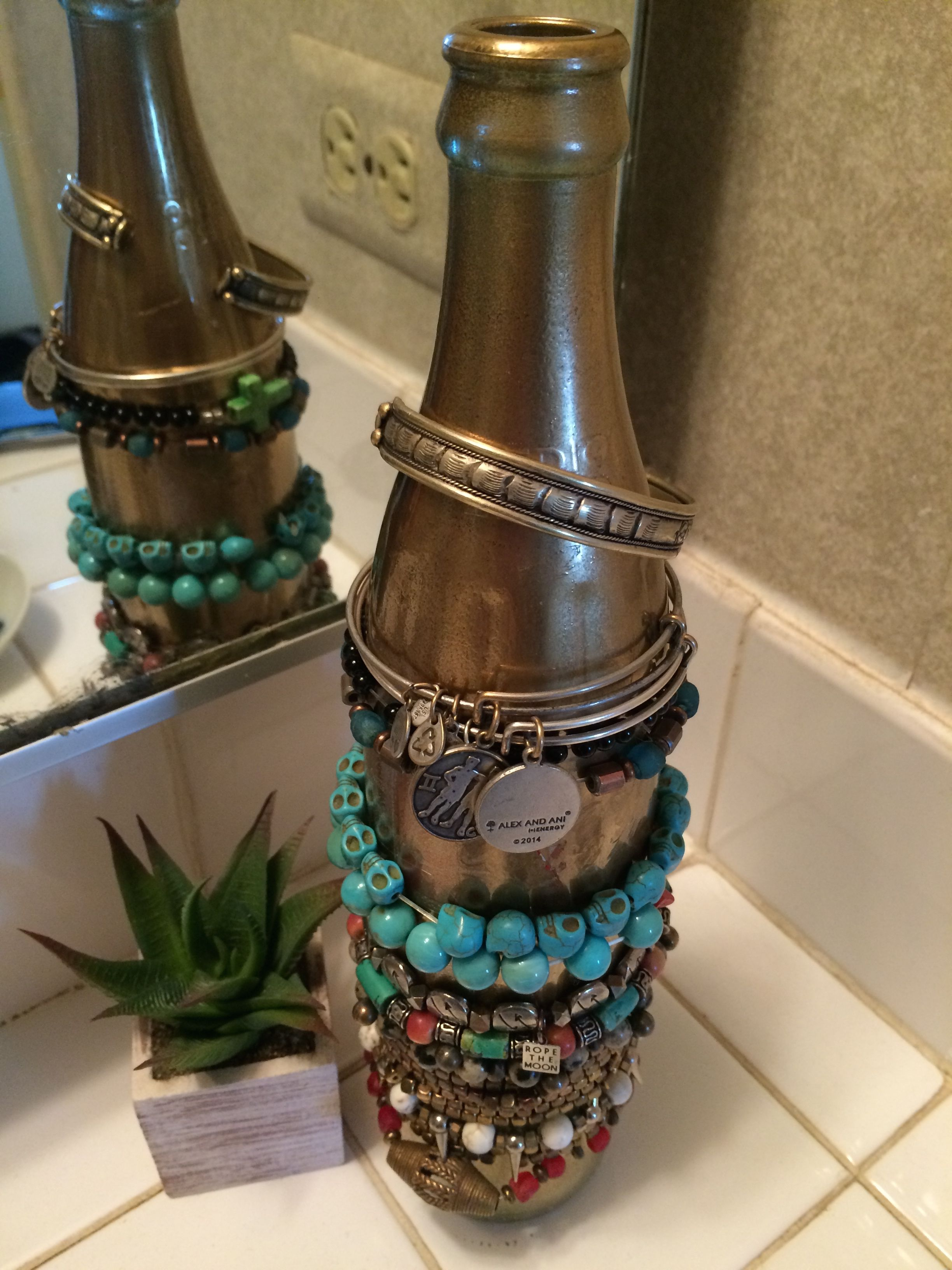 BOHO Chic Bracelet Bottle // This fabulous decorative Bracelet Bottle holder is one of my favorite DIY projects yet! This DIY bottle is perfect for organizing and holding your bracelets or hair ties in your bathroom, on a counter or anywhere in your  Read More →