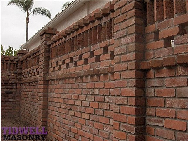 OMG I want this pierced brick wall pillars and iron garden gate
