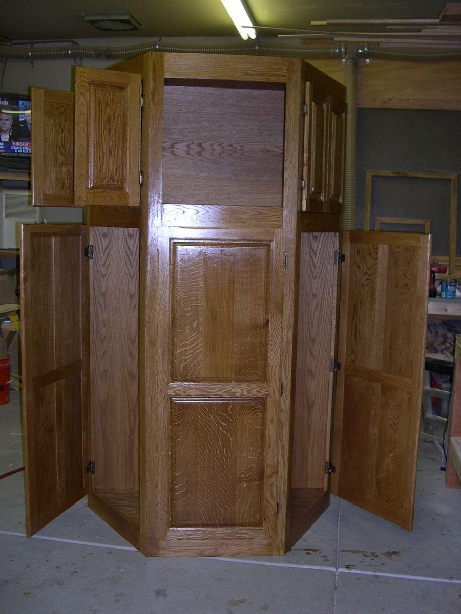 oak corner pantry with lots of doors (no digging for