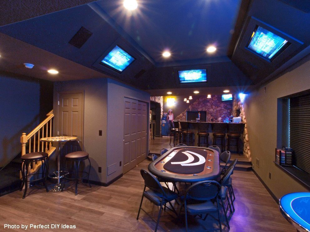 Traditional man cave basement remodel with full bar, stone accent wall in back and of course, a professional poker table. The TVs above make it. See our other favorite basement remodels by clicking on the pin. #mancavebasement