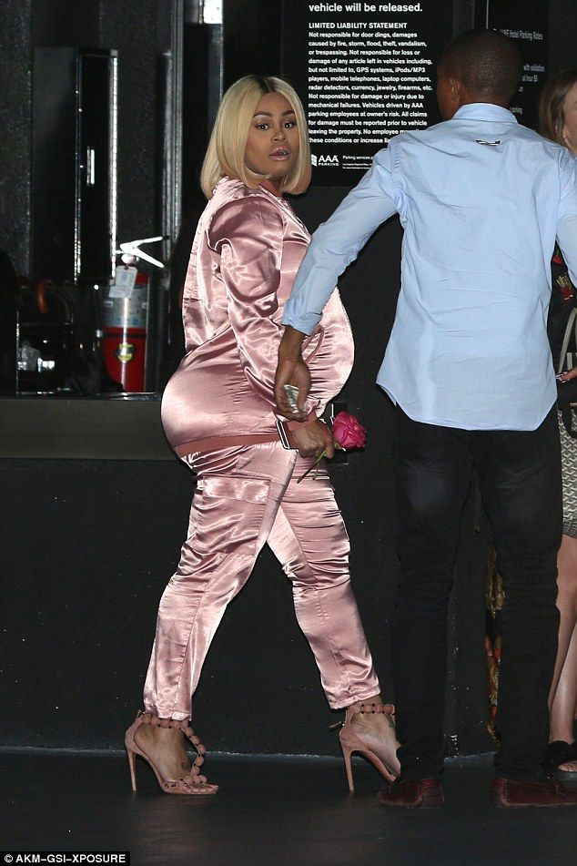 12fcc7480de1f Night on the town: Blac Chyna showed off her baby bump in a pink satin  tracksuit as she headed to best pal Amber Rose's Flirt Cosmetic event in  Los Angeles ...