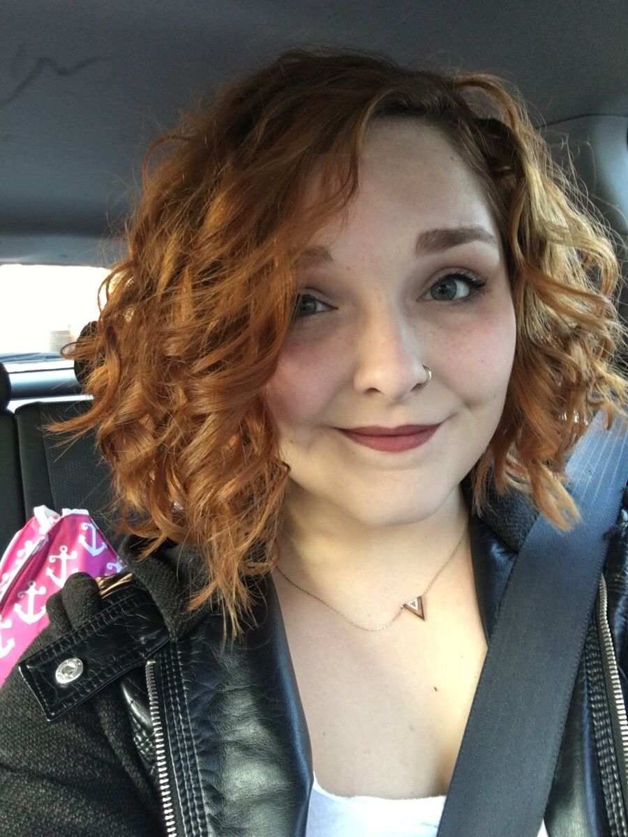 Short, asymmetrical haircuts do work with curly hair