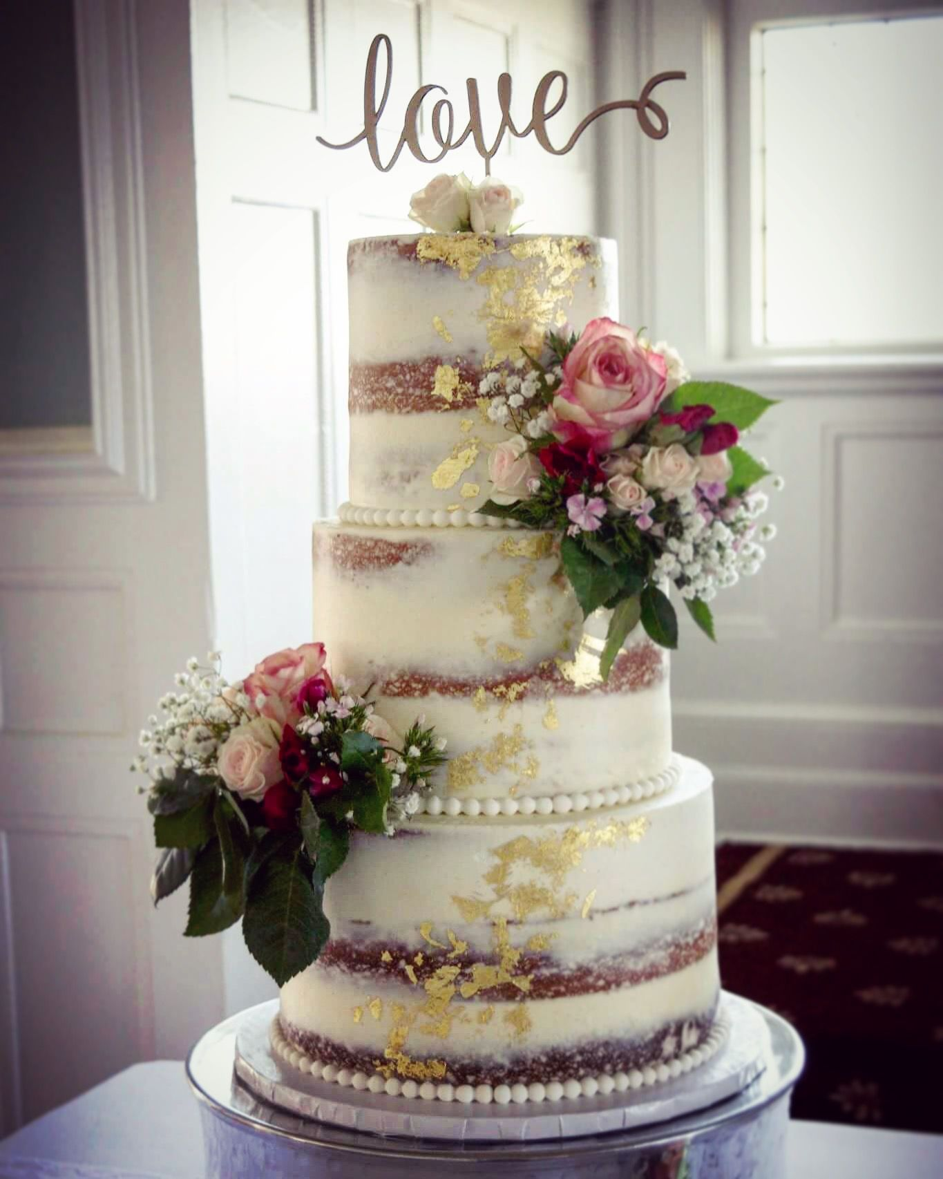 Vintage Naked Cake With Gold Foil Accents Pearls Fresh Flowers For A 1930s Themed